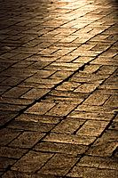 Sunlight on cobblestones