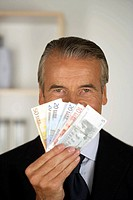 Senior businessman holding banknotes