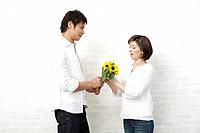 Husband giving bouquet to wife