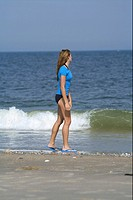 Young woman promenading at the beach