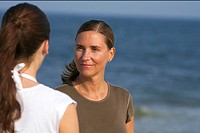 Two young women at the beach, selective focus