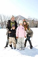 Family standing on the snowfield