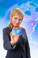 Blond woman with a credit card on a wold map background