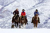 Cowboys out for a ride during winter in Shell, Whyoming, Usa