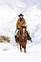 A cowgirl out for a winter ride, Shell, Wyoming, Usa