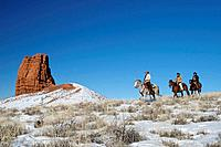 Wranglers herding horses in winter, Shell, Wyoming. Usa