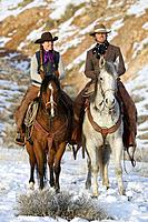 A couple out on a winter ride, Shell, Wyoming. Usa