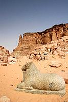 A lion guards the entrace of the Amon temple in the old town of Karima In the backyard the cliffside of the Jebel Barkal where was previsted a sculptu...
