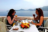On the island hotel of Sveti Stefan a breakfast on the terrace of the restaurant