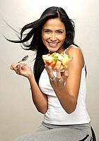 Latin model eating fruit plate