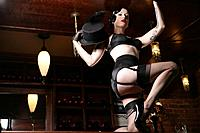 Young sexy woman doing striptease in burlesque bar (thumbnail)