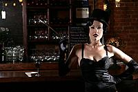 Young sexy woman smoking in burlesque bar (thumbnail)