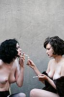 Young sexy nude women smoking