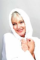 Happy mature woman in bathrobe
