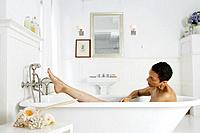 African American woman taking a bath.