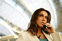 Young woman in airport on the phone