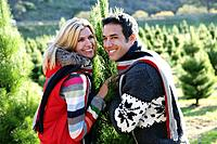 Young couple picking out Christmas tree