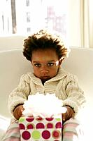 African American child with birthday present (thumbnail)