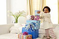African American child with birthday gifts
