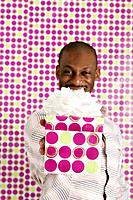 African American man holding birthday gift (thumbnail)