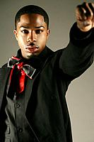 Young African American man with fist up, studio shot (thumbnail)
