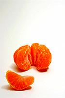 Peeled orange on white background