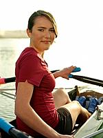 Portrait of female rower 16_17 sitting in rowing boat