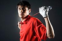 Man holding golf club, portrait