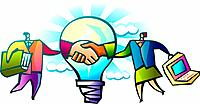 Business people shaking hands through light bulb