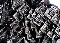 Bismuth hopper crystals. Cross_section of a sample of the mineral bismuth, showing its crystalline structure. These square_shaped crystals are known a...