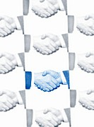 Close_up of two business men shaking hands montage
