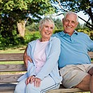 Senior Couple Sitting on Park Bench, portrait