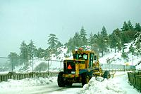 Snow plow clearing road