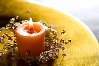 Candle on golden platter, close_up