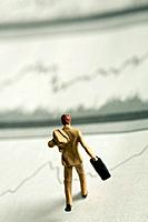 Businessman figurine running on line graph
