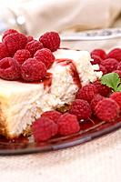 Fresh raspberries on a luscious cheesecake.