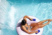 Lazily floating by a waterfall at the waterpark adds to the cooling effect on a hot summer day