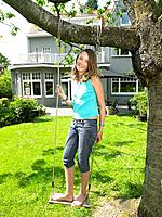 Girl on swing smiling