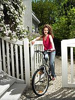 Woman riding her bicycle (thumbnail)