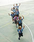 School children running in courtyard