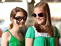 Two girls trying sun glasses