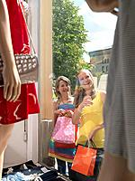 Two girls window shopping