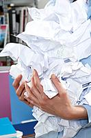 Businesswoman holding crumpled paper