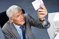 Businessman checking a 500 euro note