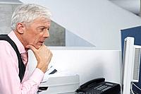 Businessman looking at his computer