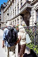 Couple walking away from camera
