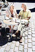 Couple sitting at café table