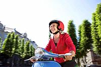 Woman driving a scooter (thumbnail)