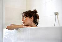 Woman relaxed in bath, eyes closed