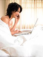 Woman in bed with computer